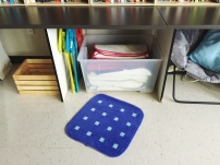 Small rugs and stools for writing workshop or reading time.